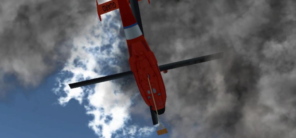 煙の向こうへ退避するヘリ